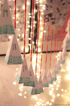 diy advent calendar garland perfect idea for brothers... now to collect the 50 little bottles of booze lol.............