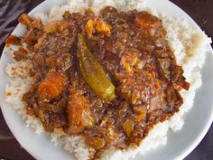 Thiou ,might be considered Senegal's take on bouillabaisse: a rustic tomato-based stew of fish or meat and chunky vegetables, served with rice.