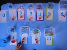 learn counting, learn numbers, teach toddler, sensory tubs, dice games, marble crafts, marbles, homeschool, preschool