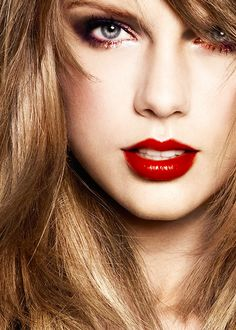 The beckoning and bewitching inviting red pout of Taylor,s lips