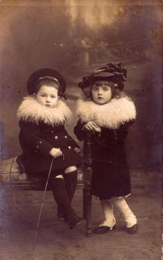 cute little Victorian/Edwardian era toddler sisters in furry jackets