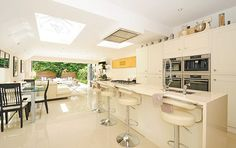 Hot property: The kitchen includes an instant boiling water tap so the couple never have t...
