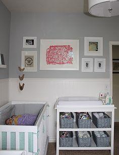 gray wall, white beadboard, modern crib