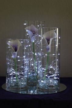 Picasso calla lilies in cylinder vases with fairy lights //Celebration Flair