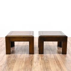 """This pair of """"Lane"""" end tables are featured in a solid wood with a dark walnut finish. These side tables have large corner legs, carved edges and low parquetry table tops. Great for the side of a sofa! #bohemian #tables #endtable #sandiegovintage #vintagefurniture"""