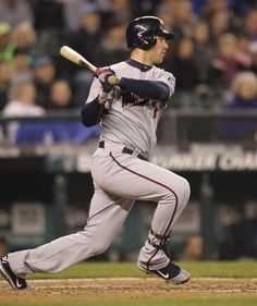 Joe Mauer #7 of the Minnesota Twins hits an RBI single in the seventh inning against the Seattle Mariners at Safeco Field on May 4, 2012 in Seattle, Washington
