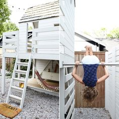 "Best Outdoor Living Space Kristin Barlowe-Clauer's Garden Birdhouse for Kids Big & Small ""The gymnastics bar is connected to the back of the birdhouse and to the fence. My office windows look directly out to the space, so I can work and referee when Backyard Fort, Backyard Playhouse, Build A Playhouse, Backyard For Kids, Backyard Landscaping, Landscaping Ideas, Kids House Garden, Children Garden, Tree Garden"