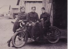 Grandpa Johnson sitting on a motorcycle in France during World War I.