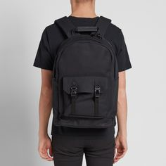"""C6 create bags designed specifically with the modern, digital world in mind. Each piece is created for the optimum functionality teamed with a simple, clean aesthetic. The New Pocket Backpack has been constructed from a durable cotton canvas, equipped with a central zipped compartment, padded laptop sleeve and an easily accessible zip pocket to the front.  Cotton Canvas Zip Closure 13"""" Padded Laptop Sleeve Zipped Pocket To Front Polished Metal Push Clips Padded Adjustable Straps"""