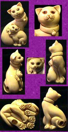 cat netsuke - awww, aren't those little feet cute