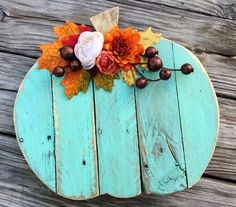 Stunning reclaimed wood pumpkin! Perfect for Fall, Halloween, Autumn and Thanksgiving decorating! 🍁 Measures approximately 13x12. 🍁 Hand cut from perfectly aged reclaimed barn wood and pallet lumber. 🍁 Top is painted sweet mint blue and distressed. 🍁 Completed with gorgeous, bright