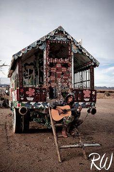 Man Playing Acoustic Guitar at Salvation Mountain, Slab City, California