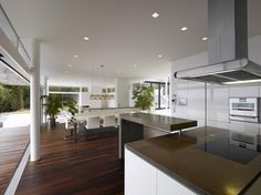 [Kitchen] : Remarkable Contemporary Modern Kitchen Room Design Along With High Gloss Brown Laminate Flooring Plus High Gloss Finish Granite Countertops Plus Four White Vinyl Dining Chairs Kitchen Room Design, Home Decor Kitchen, Kitchen Interior, Kitchen Designs, Kitchen Ideas, Kitchen Pictures, Modern Kitchen Cabinets, Kitchen Flooring, Kitchen Chairs