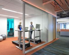 Huntsman Architectural Group redid the Oakland Kaiser office, which was inspired by tech startup style. Pictured are fitness rooms.