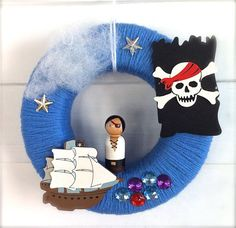 pirate themed wreathe...should be easy to make. Blue yarn, wreathe form, sea shaped jewels or stickers etc. clothespin pirate, cardboard or felt flag and ship.