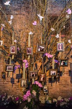 """Weddings are about bringing families together. Says event designer Amy Zaroff, """"As a unique way to showcase the family history, we brought a family tree to life at this Tuscan-themed wedding. We incorporated orchids, branches, photo frames, and lighting effects to build a creative installation, and placed the tree in the reception so that guests would pass it throughout the evening.""""Related: 7 Fun Ways to Decorate Your Wedding With Photos"""