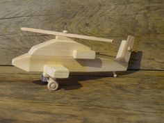 Handmade original design wood toy helicopter. 12 inches long and 5 inches wide, landing gear wheels turn and both (top and tail) propellers turn 360 degrees. Propellers are made from oak for extra durability. Made from pine, spruce, maple (wheels), oak (propellers) and glued together with non-toxic child safe glue. The helicopter has no oils, stains, or finishes applied to it. The bottom is wood burned with my initials CHH and 12 (year made). If you have any questions feel free to ask…
