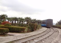 The Famous Darjeeling Himalayan Railway a.k.a the Toy Train approaching the Famous Batasia Loop