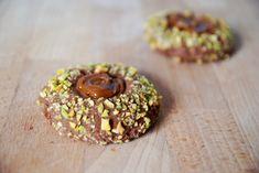 Chocolate Shortbread Thumbprints with Dulche de Leche and Pistachios