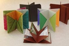 ... blizzard books ... creates pockets for tucking cards into ... as seen at : playful bookbinding & paper woeks ...