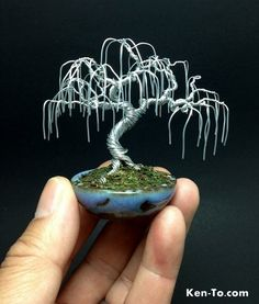 A weeping willow wire bonsai tree by Ken To in a Jim Barrett pot. Willow Wire bonsai tree in Silver by Ken To Wire Art Sculpture, Tree Sculpture, Wire Sculptures, Diy Resin Crafts, Wire Crafts, Paper Folding Crafts, Bonsai Wire, Mini Bonsai, Handmade Wire Jewelry