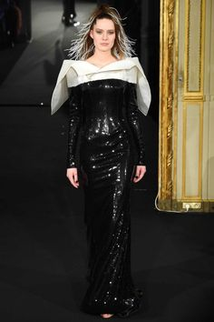 Looks like she has shoved giant tissues down her bra!  Alexis Mabille: Paris Haute Couture Spring/Summer 2015