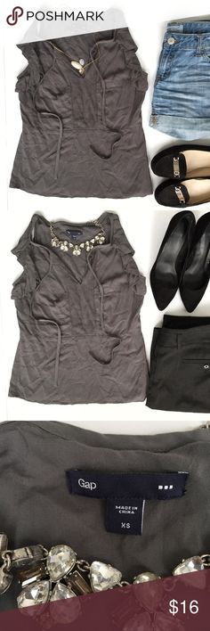 GAP Sleeveless Grey Blouse Beautiful and versatile GAP blouse in size xs. It can be dress up for the office -with dress pants and heels, or dress down for a fun look! It features ruffles at arm opening. GAP Tops Blouses