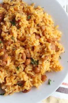 This recipe for Mexican Rice and Beans is super quick and simple. Make this for lunch or dinner – simply delicious! This recipe for Mexican Rice and Beans is super quick and simple. Make this for lunch or dinner – simply delicious! Mexican Beans And Rice, Mexican Dishes, Pinto Beans And Rice, Recipes With Pinto Beans, Vegan Rice And Beans Recipe, Mexican Moms, Recipes With Refried Beans And Rice, Recipe Using Pinto Beans, Vegan Brown Rice Recipes