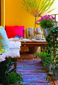 Simple decor for a small balcony. Love how the colors blend together.