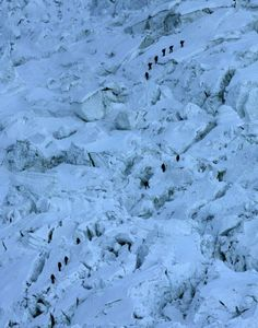 Mountaineers pass through the treacherous Khumbu Icefall on their way to Mount Everest near Everest Base camp