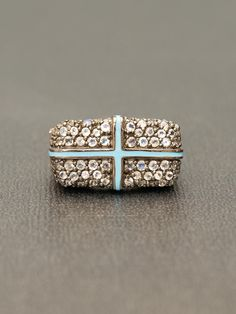 m.c.l. design. sterling silver, moonstone and blue enamel cross ring. pretty cool.