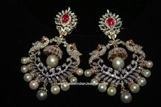Brilliantly designed large diamond chand bali earrings with peacock design and a small jhumki drop in the middle of the balis.