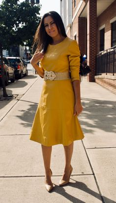 Most women focus their wardrobes around traditional, linear garments, resulting in a bland and uninspired appearance. However, how often do you see a long-sleeve yellow leather dress? It is already rare to see a black leather dress, so why not yellow? Black Leather Dresses, Faux Leather Skirt, Yellow Leather, Stylish Dresses, Nice Dresses, Dresses For Work, Wool Dress, Dress First, Wardrobes