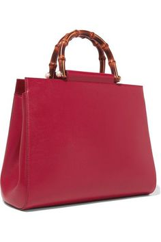 Red leather (Calf) Open top Designer color: Hibiscus Comes with dust bag This style is made with natural bamboo and as such may have small indentations Weighs approximately 2.2lbs/ 1kg Made in Italy