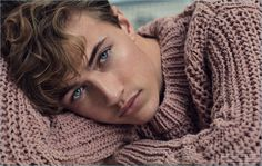 Delivering a beauty close-up, Lucky Blue Smith wears a Maison Margiela sweater.