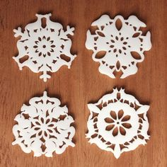 make a present fancy with bakers twine and mini snowflake ornaments from peppersprouts acrylic laser cut animals snowflakes mini tree ornaments