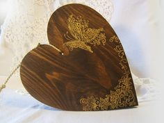 Wooden heart with golden butterfly