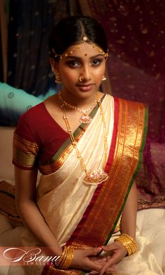 traditional South Indian tamil Bride wearing bridal saree and jewellery.