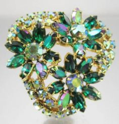 Check out this item in my Etsy shop https://www.etsy.com/listing/544518333/big-emerald-green-rhinestone-flower