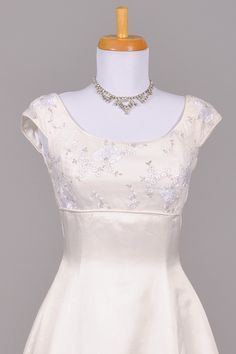 1970s Silver Embroidered Empire Vintage and I like the neckline in the front- not so much of the back