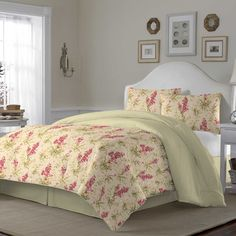 A rustic green and pink floral pattern gives this Hannah comforter a charming feel that is sure to brighten any bedroom decor. Accented with shams and a bedskirt, this beautiful cotton comforter set reverses to a simple foulard print.