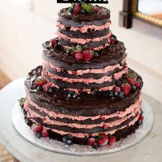 It's all about the naked wedding cake as brides are going for a more rustic look rather than traditional. Drop all the extra icing and add some berries.