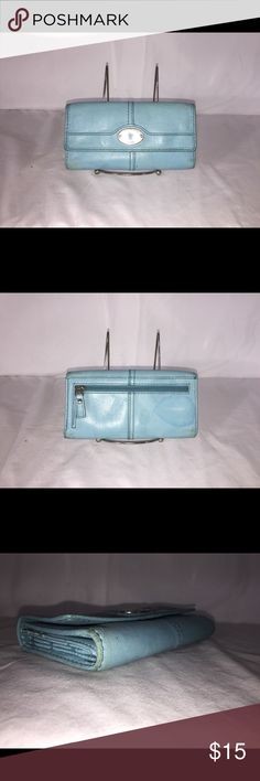 Light blue leather fossil wallet Women's light blue fossil wallet  Wallet is in fair conditions doesn't contain rips however, wallet contains minor stains  Asking for $18 but open to any offer Fossil Bags Wallets