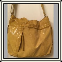 💥$⬇️💥Perlina Shoulder Hobo/Embossed Snakeskin Stylish Perlina hobo in yellow embossed snakeskin. Excellent condition! One inside zipper pocket and 2 slip pockets. One outside vertical zipper pocket. Magnet closure. Strap drop is adjustable so that you may carry it however you want! Perlina Bags Hobos