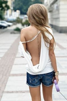 spine tattoo - Love the location
