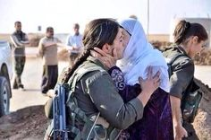 A Kurdish mother sending her daughter off to fight ISIS extremist militants in Northern Syria. Allah yerhamha.