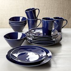 Our most coveted casual dinnerware collection recalls the warm hospitality of Portugal's quaint seaside cafes. Glazed deep Mediterranean blue, each free-form stoneware item in the four place settings is hand-antiqued at the rim by Portuguese artisans.