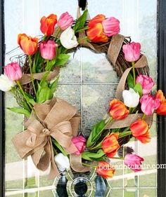 This is the perfect decoration to welcome people into your home—and to greet spring. A grapevine base makes the wreath feel natural, but silk flowers mean it will stay alive and bright for the entire season.
