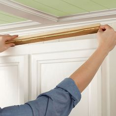 How-to guide on adding moulding to kitchen cabinets... glad we bought the air compressor and nail gun thingy!