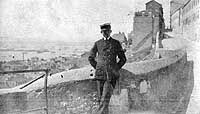 One of USS JEANETTE SKINNER's Chief Petty Officers tours an old port city, probably in France or Spain, circa 1918-1919.